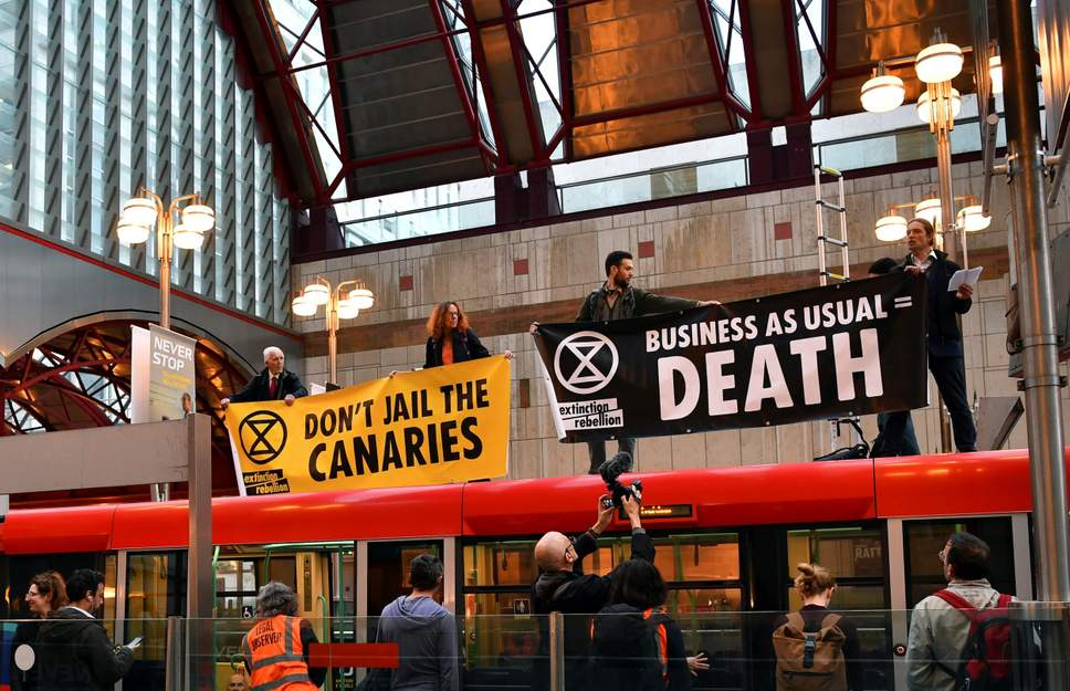 Climate-change protesters target London Stock Exchange and Canary Wharf
