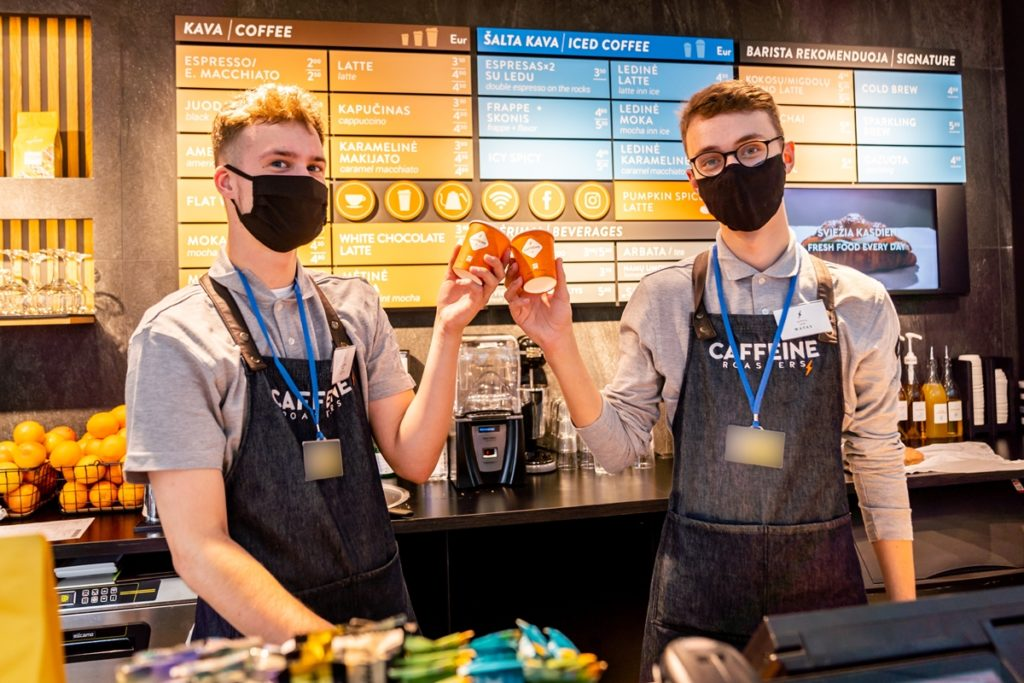 Baristas brew the coffee at Caffeine, which is commonly found in tourist locations across Lithuania